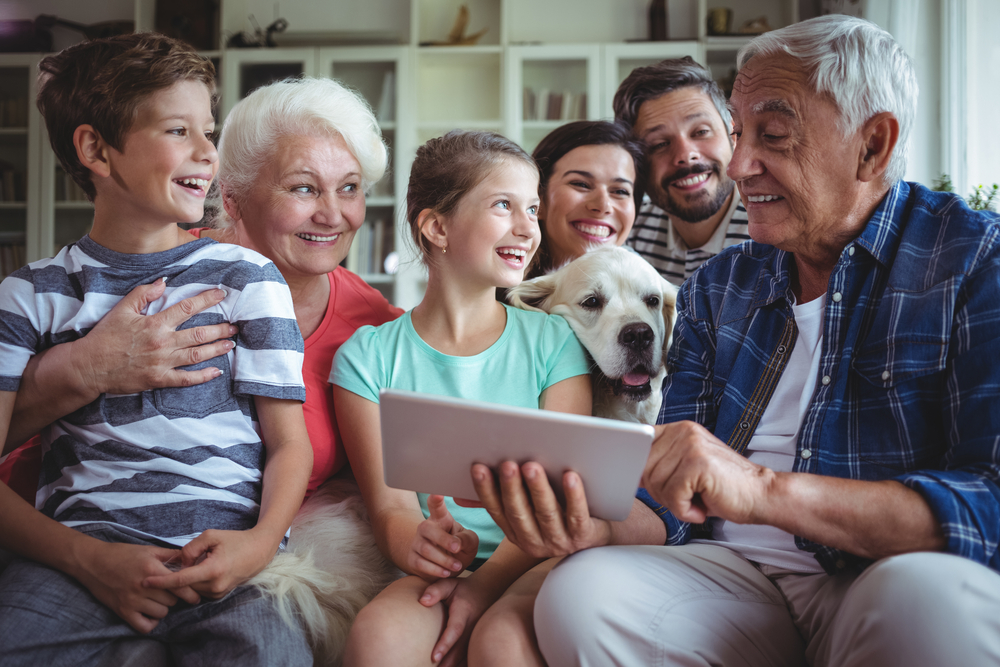 happy multigenerational family using a tablet to read something