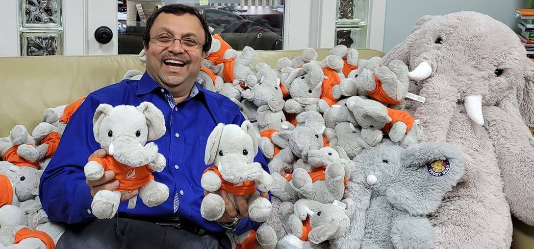 Author Parthiv Shah surrounded by BRENT mascots