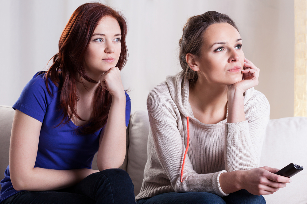two women looking interested in something online