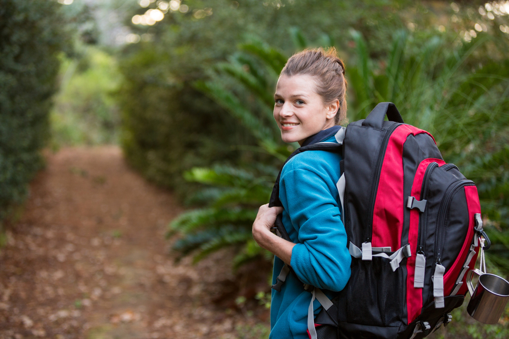 young woman hiking on a trail