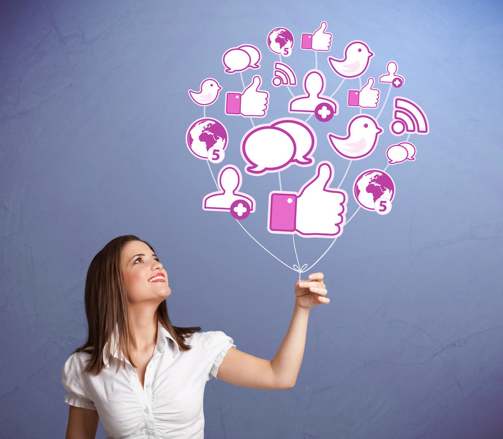woman holding balloon with social media icons